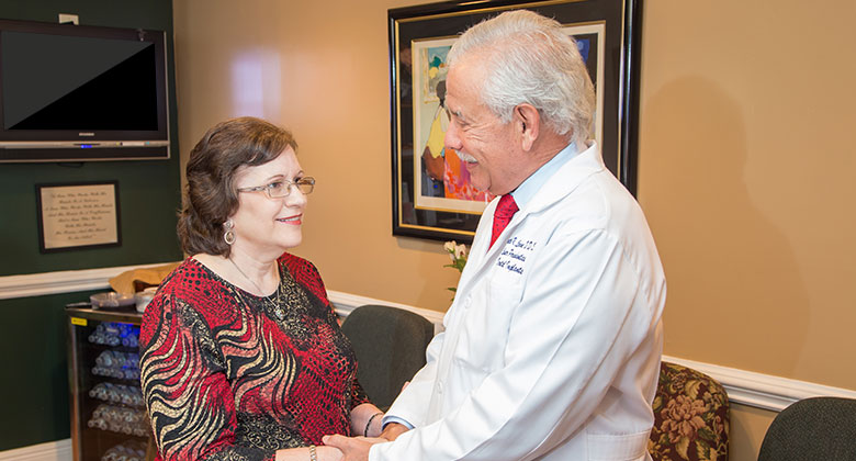 Dr. Levine welcoming patient