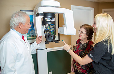 Dr. levine and assistant with patient at CT machine