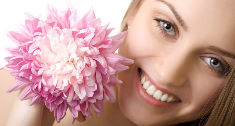 beautiful smile woman with flower isolated